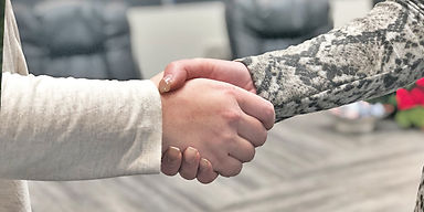 Client and project coordinator shaking hands after a successful project