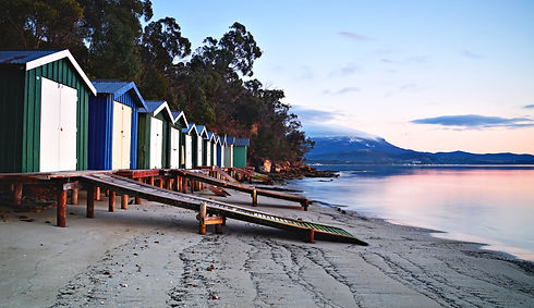 Sunrise over beach huts in Hobart, Tasma