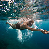 Professional female swimmer swim in the