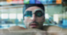 professional swimmer leaning at the pool