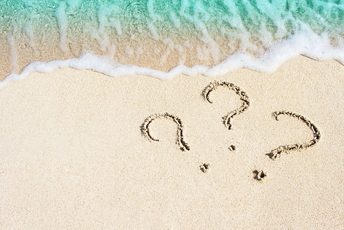 question mark sign handwritten in sand b
