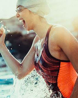 Excited female swimmer with clenched fis