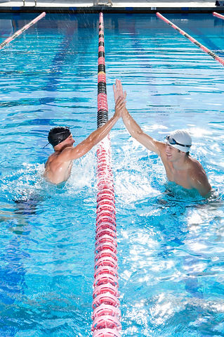 Competitive male swimmers in swimming po