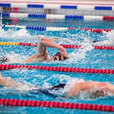 Male swimmers competing in a race. Anony