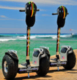 Hawaii Hoverboarding Tours all-terrain segway-style hoverboards at beach.