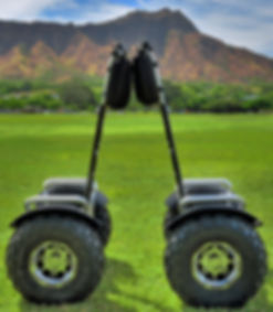 All-terrain segway-style hoverboards in front of Diamond Head. Hawaii Hoverboarding Tours