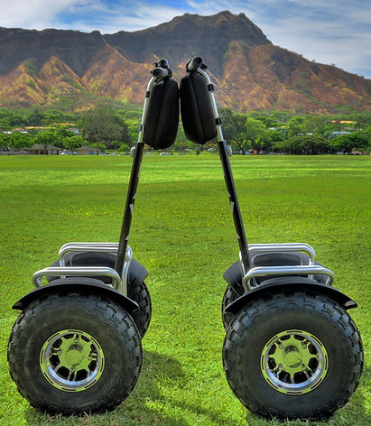 All-terrain electric hoverboards in front of Diamond Head. The best Waikiki guided tours.