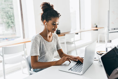 romantic-african-woman-with-trendy-hairstyle-sitting-her-workplace-analysing-data-indoor-p
