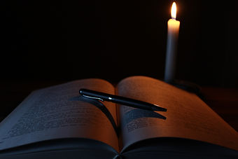 Canva - Book and Pen in the Dark.jpg