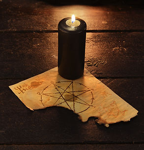 Canva - Black candle with pentagram.jpg