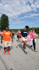 Christian Johnson, Charles Newman, and Melissa Wilde marching in Pickerington's Labor Day parade
