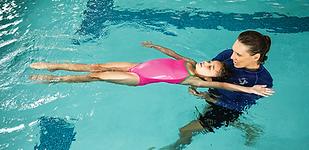 Swim Instructor teaching a swimmer backs