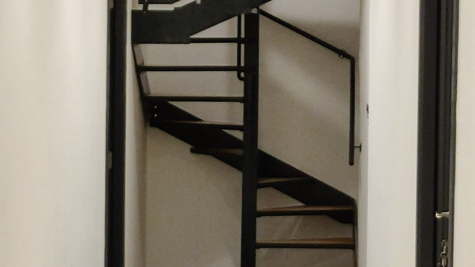 Steel staircase with wooden stepd