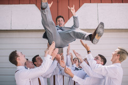 groom thrown up, groomsmen throwing groom, illinois wedding photographer, central illinois wedding p