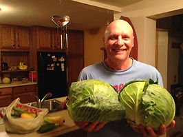 Ric Holding Huge Cabbage Heads