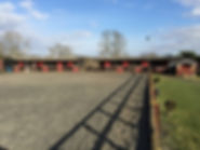 View of Poppyfield Equestrian Riding School Yard and Outdoor Arena