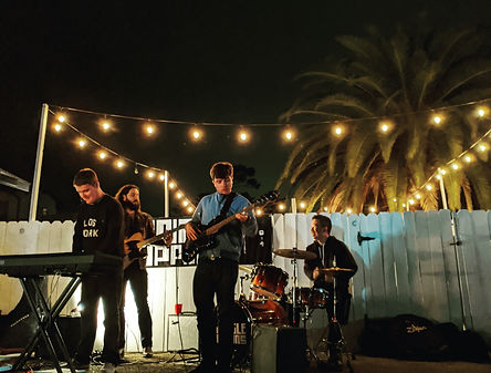 band playing outdoors underlights