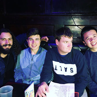 bandmates with and without autism smiling before a gig