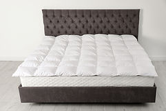 Comfortable bed with new mattress near w
