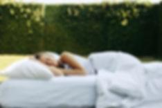 Teenage girl sleeping on soft mattress a