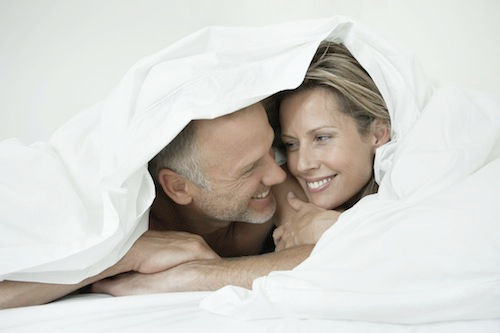 couple under a Snowgoose white goose down comforter