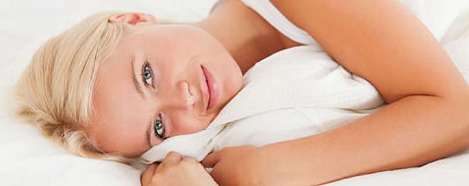 lady hugging Eiderdown comforter