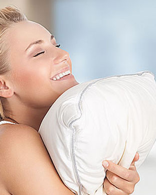 lady hugging white goose down pillow