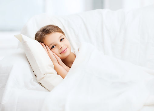 girl under down comforter with down pill