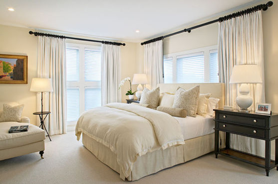 ivory duvet cover over a white goose down comforter set in beautiful bedroom