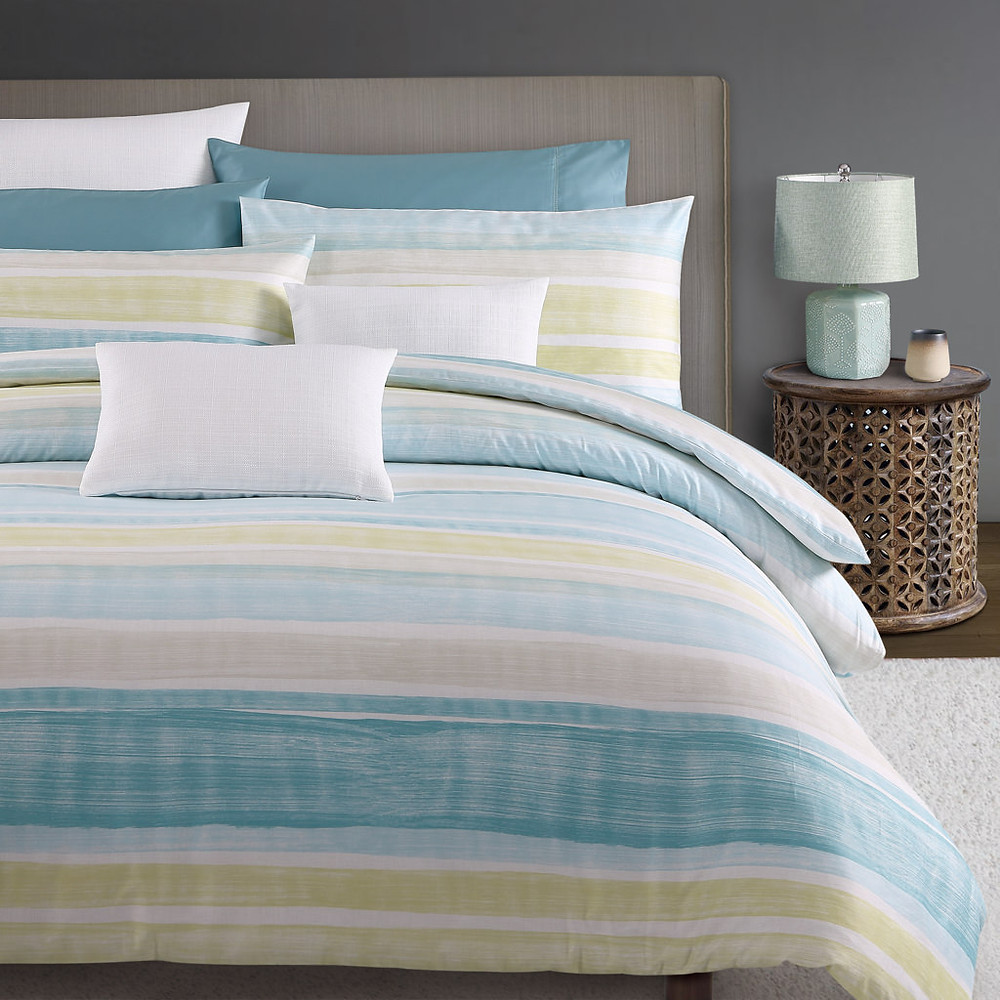aqua, pink, yellow stripe cotton sateen duvet cover and pillowcases on luxury down comforter and goose down pillows