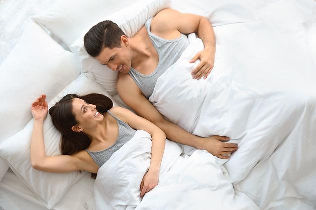 couple under goose down luxury comforter