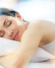 lady sleeping on white goose down pillow