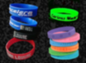 Close up of Embossed Silicon wristband, Debossed / Debossed with ink filled and Glow in the Dark bands