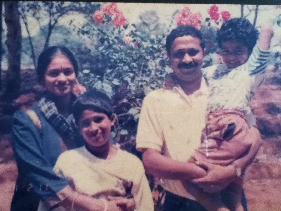 A young Abhi (second from left), with family