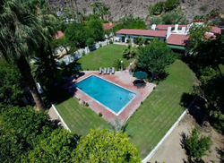 An acre of lush greenery, fruit trees an