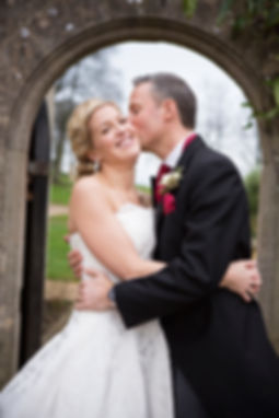 Groom kissing bride, coombe lodge wedding, blagdon, happy bride