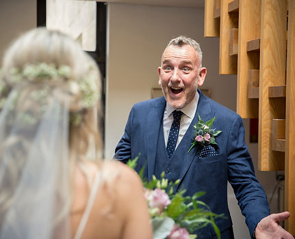 father of the bride seeing bride in wedding dress for the first time