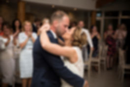bride and groom kissing, first dance, love