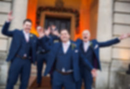 groomsmen throwing hands in the air