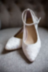 brides wedding shoes on chair