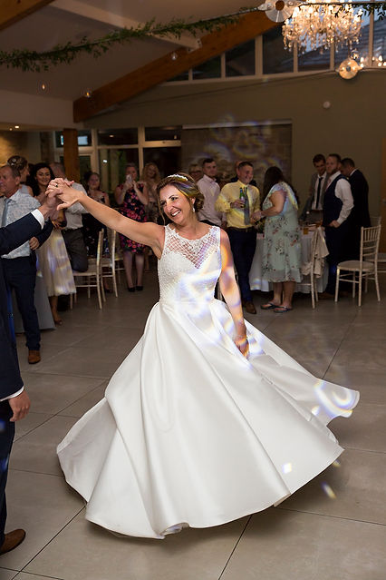 bride dancing and swirling dress