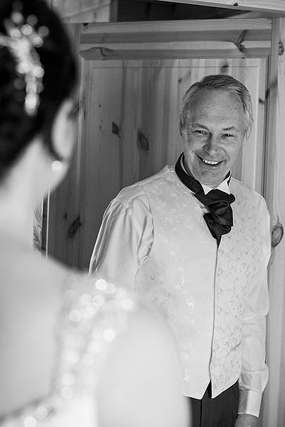 Father seeing his daughter for first time in wedding dress