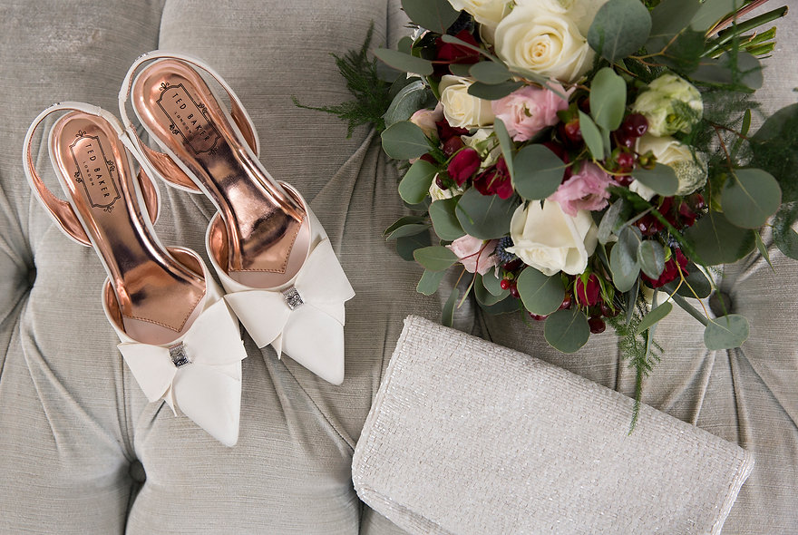 Brides shoes, bouquet and bag