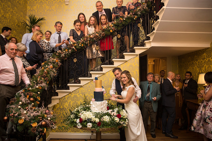 cutting the cake, guests up the stair case