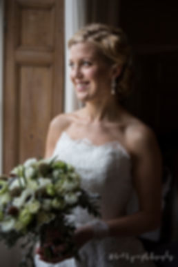 Bride, bouquet, window light
