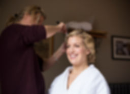 bride getting her hair done, bridal prep