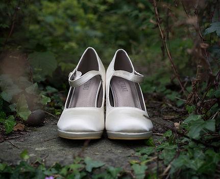 wedding shoes, brides shoes amongst foliage