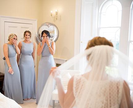 Bridesmaids seeing bride