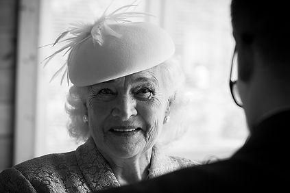 Grand mother enjoying seeing groom dressed up