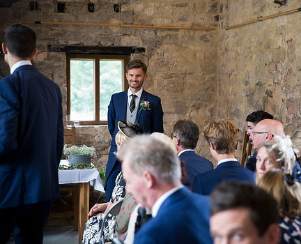 groom waiting for bride at tithe barn Bradford-on_avon